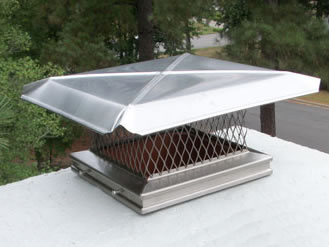 One chimney cap installed on the top of chimney, the metal sheet acts as the cap cover, its four sides are downward.