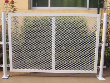 There Is A White Expanded Metal Fence Sample, It Is Installed With Metal  Column.
